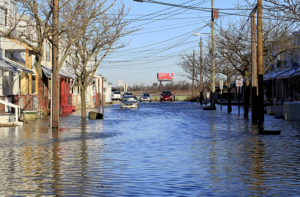 A view of Arizona Avenue looking towards the bay from Fairmount Avenue is seen as high tides flood neighborhood streets after a powerful snowstorm struck the U.S. East Coast, in Atlantic City, New Jersey