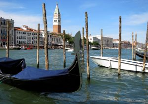 A gondola is pictured in the Grand Canal (Canale Grande) in Venice lagoon with the Campanile belltower in Venice