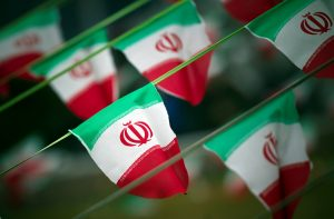 File photo of Iran's national flags by Morteza Nikoubazl/Reuters
