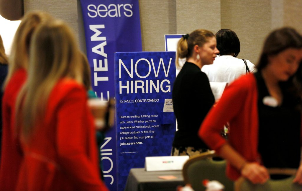 Recruiters and job seekers are seen at a job fair in Golden, Colorado, June 7, 2017. REUTERS/Rick Wilking - RTX39HTG