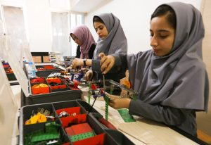 Members of Afghan robotics girls team which was denied entry into the U.S. for a competition, work on their robots in Herat province, Afghanistan. Photo by Mohammad Shoib/Reuters