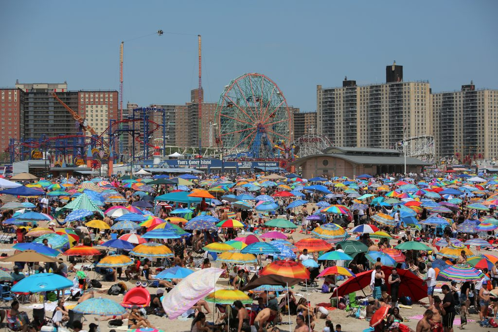 Beachgoers gather at Coney Island Beach on the Independence Day holiday in Brooklyn. Photo by Andrew Kelly/Reuters