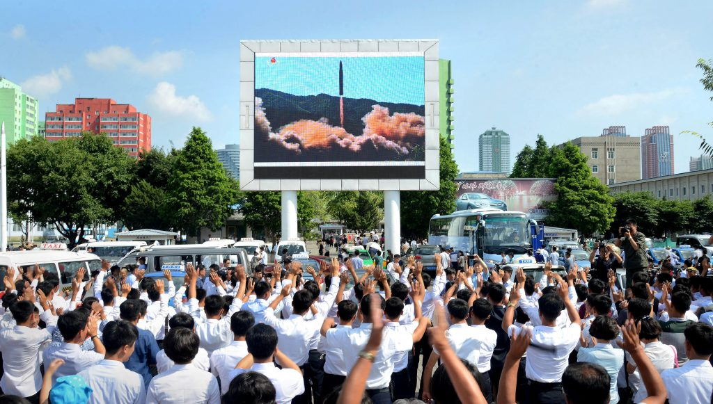 People watch a huge screen showing the test launch of intercontinental ballistic missile Hwasong-14 in this undated photo released on July 5, 2017, by North Korea's Korean Central News Agency (KCNA). Photo by KCNA/via Reuters