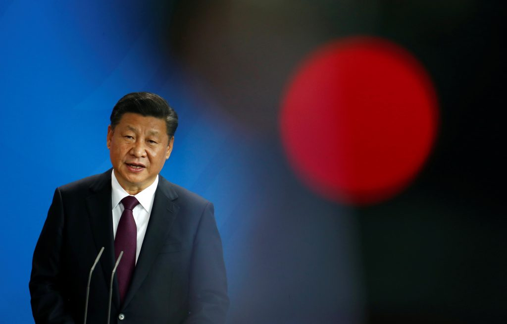Chinese President Xi Jinping attends a news conference at the Chancellery in Berlin