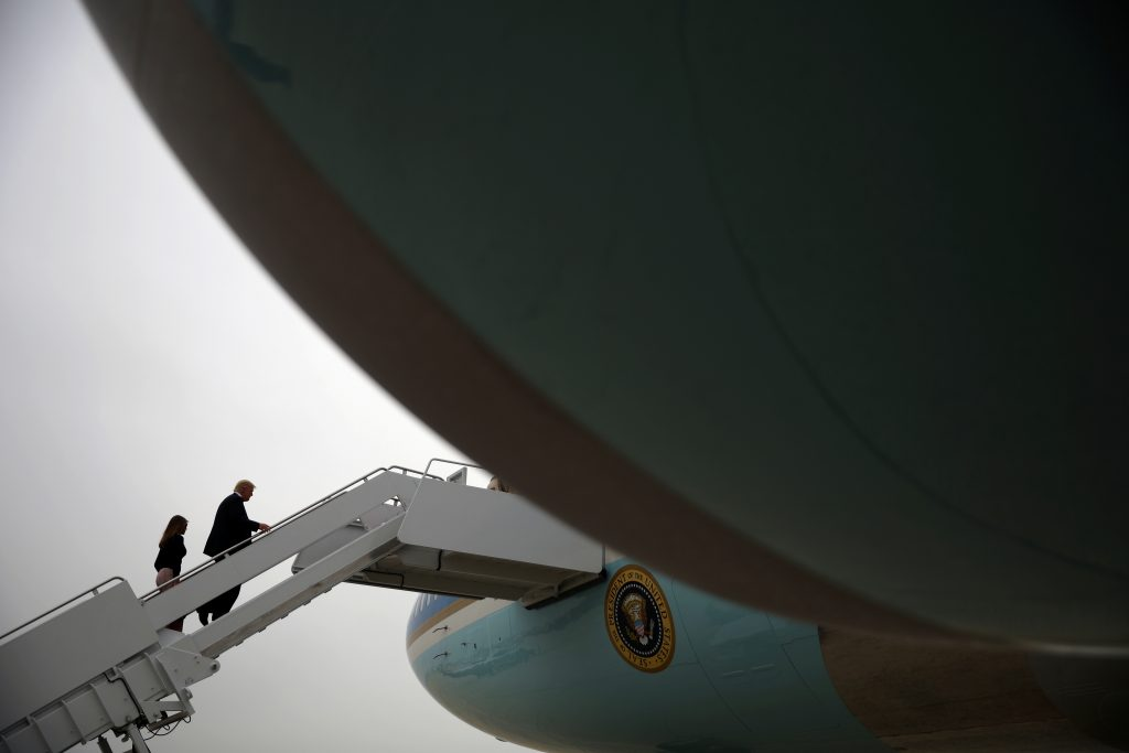 President Donald Trump and First Lady Melania Trump board Air Force One for travel to Poland from Joint Base Andrews, Maryland. Photo by Carlos Barria/Reuters