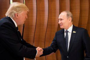 U.S. President Donald Trump and Russia's President Vladimir Putin shake hands during the G20 Summit in Hamburg