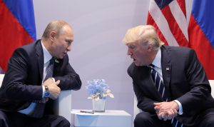 U.S. President Donald Trump speaks with Russian President Vladimir Putin during the their bilateral meeting at the G20 summit in Hamburg, Germany July 7, 2017. REUTERS/Carlos Barria - RTX3AI4X