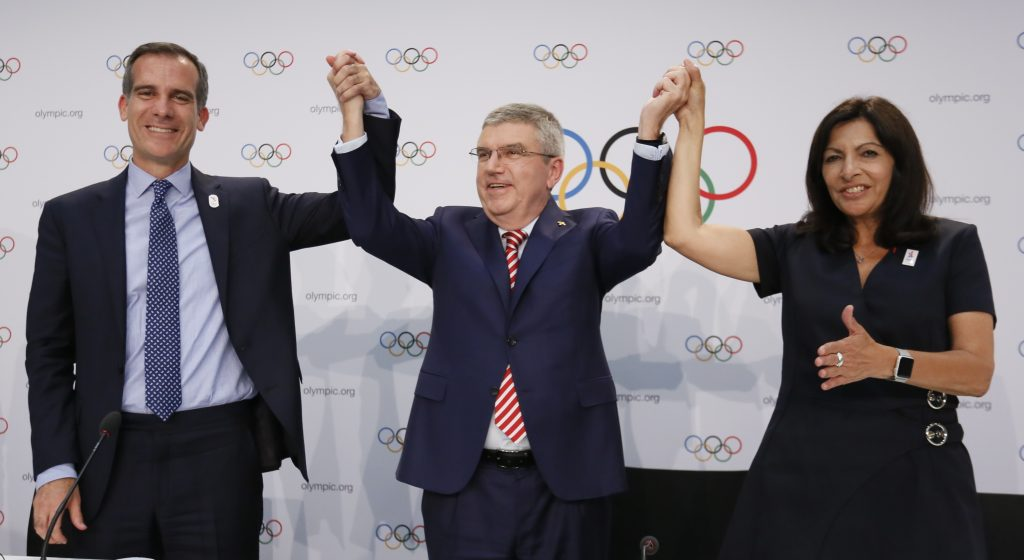 International Olympic Committee (IOC) President Thomas Bach, Mayor of Los Angeles Eric Garcetti and Mayor of Paris Anne Hidalgo gesture during the press conference after the voting at the IOC extraordinary session in Lausanne, Switzerland July 11, 2017. REUTERS/Pierre Albouy - RTX3B0XS