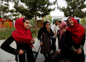 Members of Afghan robotics girls team chat with each others as they arrive to receive their visas from the U.S. embassy in Kabul