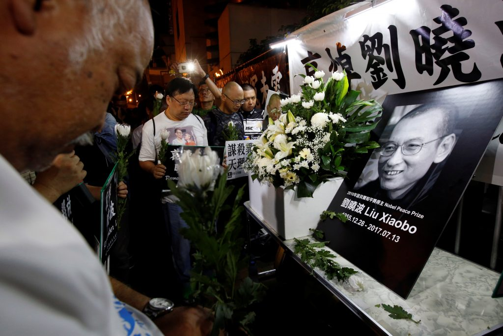 Pro-democracy activists mourn the death of Chinese Nobel Peace laureate Liu Xiaobo in Hong Kong