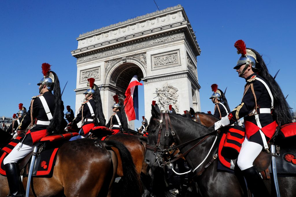 French Republican Guards on horseback pass near the Arc de Triomphe. Photo by Etienne Laurent/Pool via Reuters