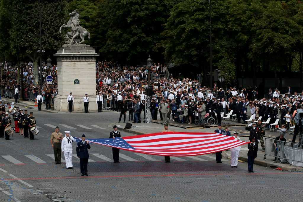 An American flag is displayed during the parade, which also celebrated the U.S. entry into World War I. Photo by Gonzalo Fuentes/Reuters