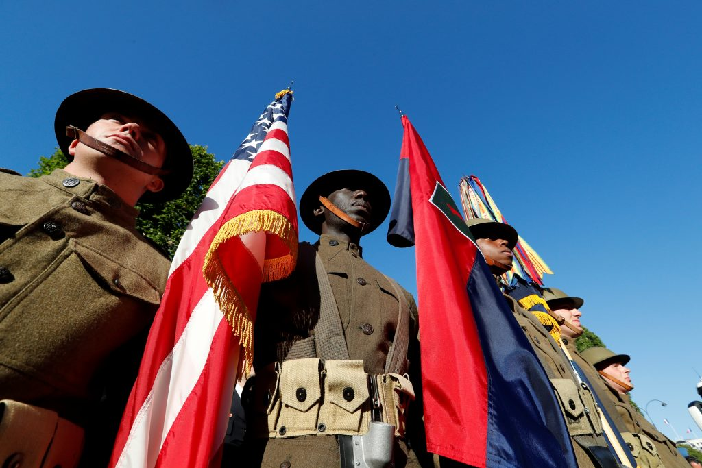 U.S. troops wearing World War I helmets walk in the Bastille Day military parade. Photo by Yves Herman/Reuters