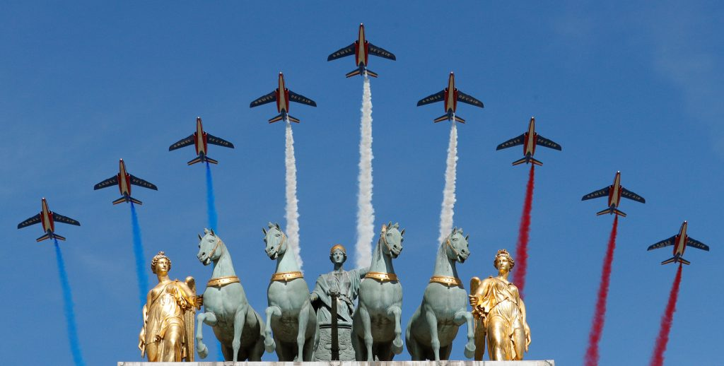 Alpha jets from the French Air Force Patrouille de France fly over the Arc de Triomphe du Carrousel. Photo by Philippe Wojazer/Reuters