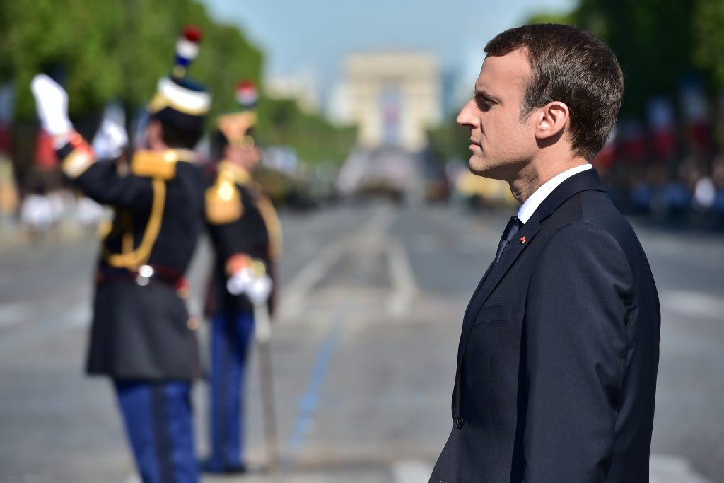French President Emmanuel Macron attends the traditional Bastille Day military parade on the Champs-Elysees avenue in Paris