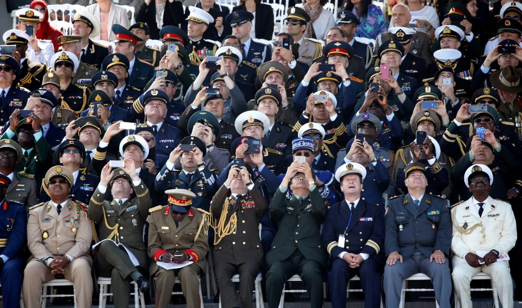 High ranking officers from various countries take pictures of fly overs. Photo by Charles Platiau/Reuters
