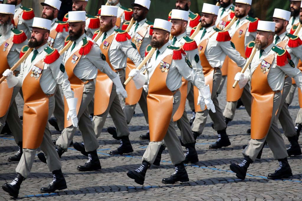 Pioneers of the 1st Foreign Legion regiment carry axes in the Bastille Day parade. Photo by Charles Platiau/Reuters