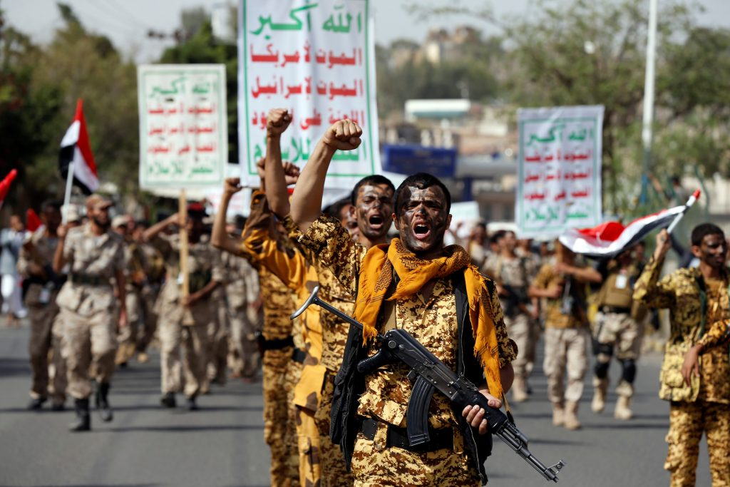 Newly recruited fighters parade outside the U.S. embassy before they join Houthi rebels in the battles at the border with Saudi Arabia and in other parts of Yemen. Photo by Khaled Abdullah/Reuters