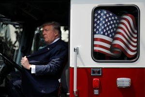 "U.S. President Donald Trump sits on a firefighter truck as he attends a ""Made in America"" products showcase event at the White House in Washington, U.S., July 17, 2017. REUTERS/Carlos Barria - RTX3BUAI"