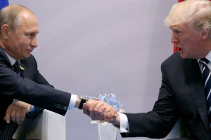 FILE PHOTO - U.S. President Donald Trump shakes hands with Russian President Vladimir Putin during the their bilateral meeting at the G20 summit in Hamburg, Germany July 7, 2017. Photo By Carlos Barria/Reuters