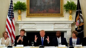 U.S. President Donald Trump speaks during a lunch meeting with Senate Republicans to discuss healthcare at the White House in Washington, U.S., July 19, 2017. From left are U.S. Senators Shelley Moore Capito (R-WV), Dean Heller (R-NV), Tim Scott (R-SC) and Lisa Murkowski (R-AK). REUTERS/Kevin Lamarque TPX IMAGES OF THE DAY - RTX3C4S7