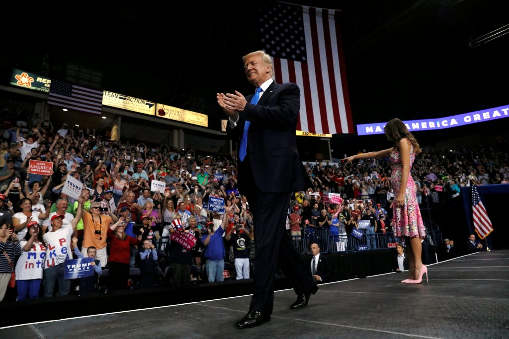 President Donald Trump and first lady Melania Trump take the stage for a rally with supporters in an arena in Youngstown, Ohio. Photo by Jonathan Ernst/Reuters