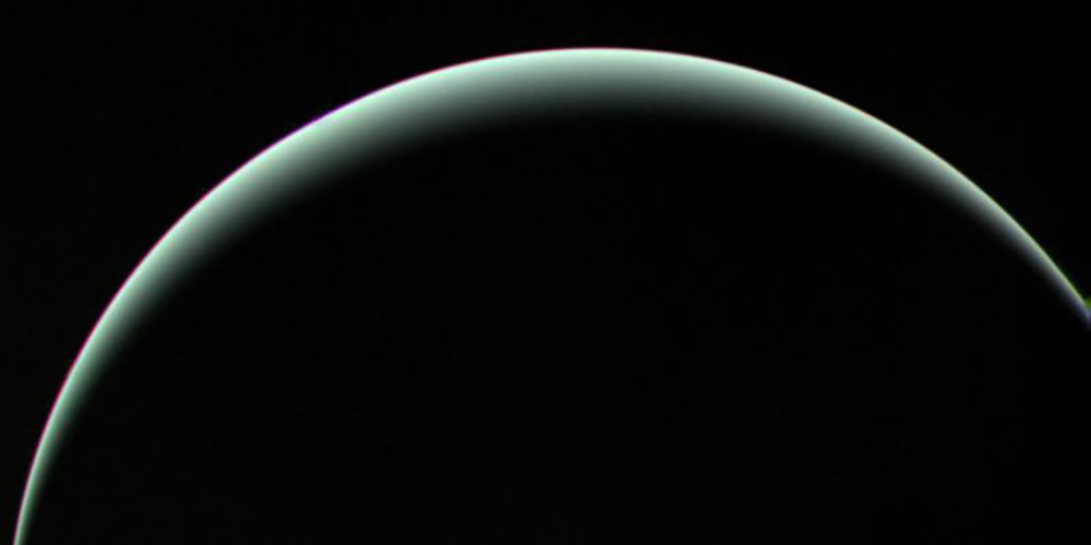 Farewell shot of Uranus' crescent as Voyager 2 departed the icy giant on  January 25, 1986. Photo by NASA
