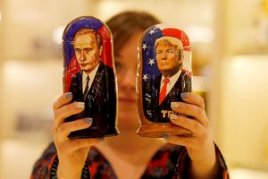 MOSCOW, RUSSIA - JANUARY 17: Painted Matryoshka dolls, or known as Russian nesting dolls, bearing the faces of Russian President Vladimir Putin and President-elect Donald Trump are offered in a souvenir shop in Moscow, Russia on January 17, 2017. (Photo by Sefa Karacan/Anadolu Agency/Getty Images)