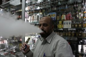Manager of Brooklyn Vape store Mohammed Isa smokes an e-cigarette in Brooklyn, New York, U.S., January 18, 2017. REUTERS/Joe Penney - RTSW548