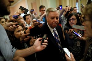 U.S. Senator Lindsey Graham (R-SC) is surrounded by reporters as he departs a Senate Republican caucus meeting about an expected unveiling of Senate Republicans' revamped proposal to replace Obamacare health care legislation at the U.S. Capitol in Washington, U.S. July 13, 2017. REUTERS/Jonathan Ernst - RTX3BCQ6