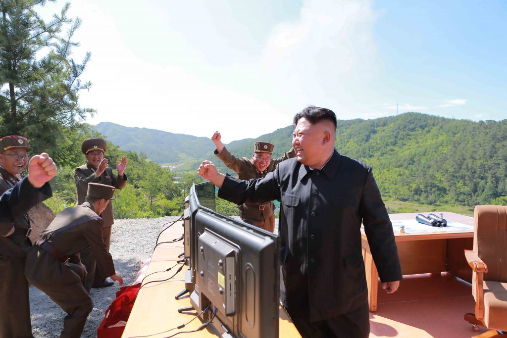 North Korean Leader Kim Jong Un reacts during the test-fire of intercontinental ballistic missile Hwasong-14 in this undated photo released by North Korea's Korean Central News Agency (KCNA) in Pyongyang, July, 4 2017. KCNA/via REUTERS ATTENTION EDITORS - THIS IMAGE WAS PROVIDED BY A THIRD PARTY. REUTERS IS UNABLE TO INDEPENDENTLY VERIFY THIS IMAGE. NO THIRD PARTY SALES. SOUTH KOREA OUT. - RTX39YID