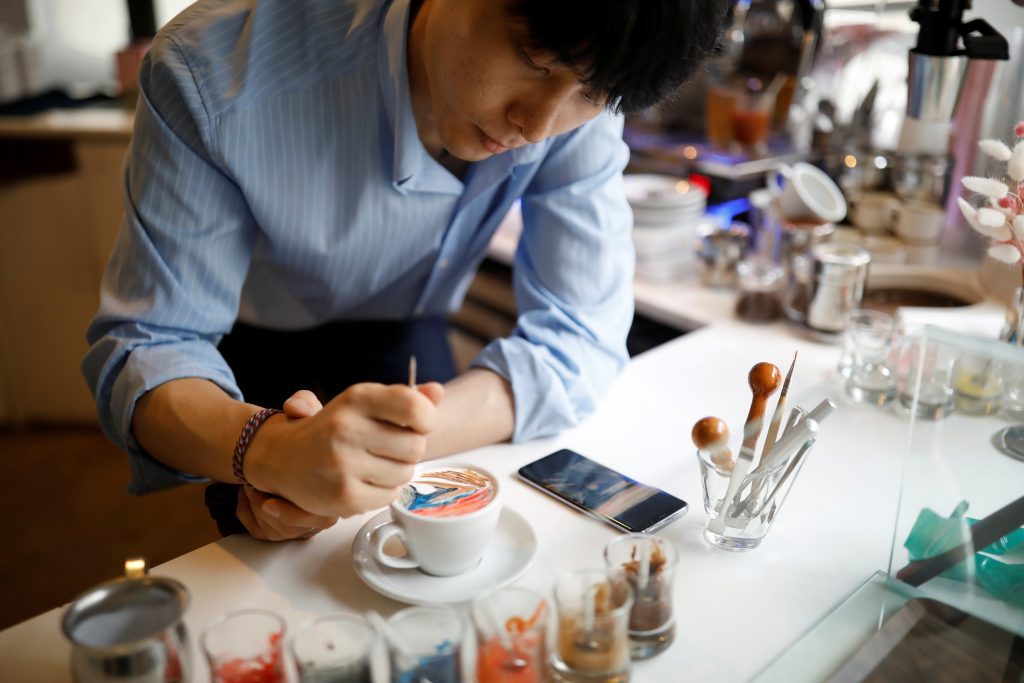 South Korean barista Lee Kang-bin makes his latte arts called 'creamart' at his coffee shop in Seoul, South Korea, June 30, 2017. Picture taken on June 30, 2017. REUTERS/Kim Hong-Ji NO RESALES. NO ARCHIVE. - RTS19JC9