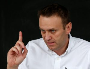 Russian opposition leader Alexei Navalny gestures during an interview with Reuters in Moscow