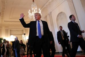 U.S. President Donald Trump waves as he leaves a Made in America roundtable meeting in the East Room of the White House in Washington, U.S. July 19, 2017. REUTERS/Carlos Barria - RTX3C4VE