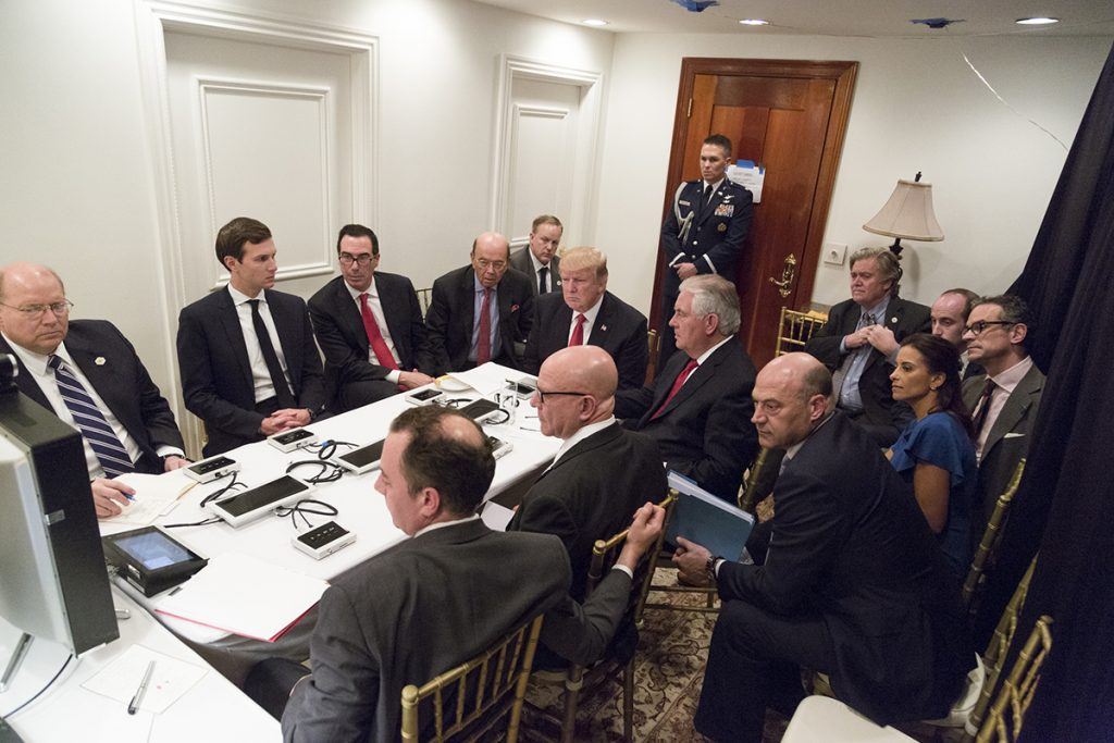 President Donald Trump receives a briefing, Thursday, April 6, 2017, on a military strike on Syria from his National Security team, including a video teleconference with Secretary of Defense, Gen. James Mattis, and Chairman of the Joint Chiefs of Staff, Gen. Joseph F. Dunford, in a secured location at Mar-a-Largo in Palm Beach, Florida. (Official White House Photo by Shealah Craighead) Editor's Note: Items in this image have been altered for security purposes.
