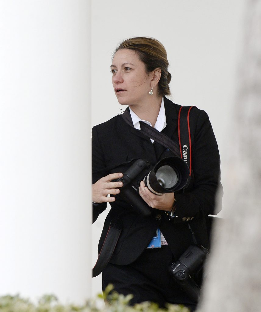 Shealah Craighead, President Donald Trump's Chief Official White House Photographer, is seen working during UK Prime Minister May's visit to the White House on January 27, 2017 in Washington, D.C. Photo by Olivier Douliery-Pool/Getty Images