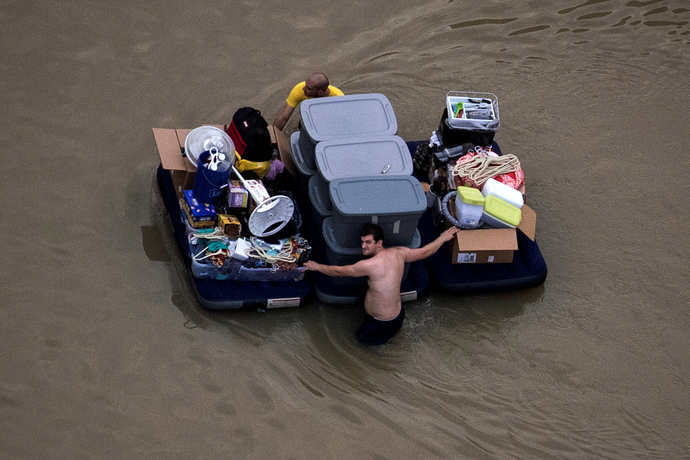 Residents wade with their belongings through flood waters brought by Tropical Storm Harvey in Northwest Houston, Texas, U.S. August 30, 2017. Photo by  Adrees Latif/REUTERS