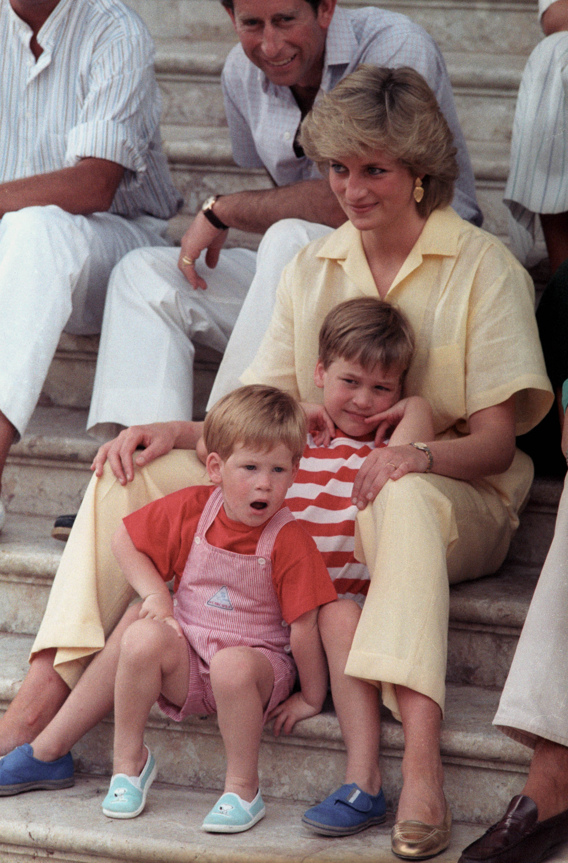 Princess Diana holds her two sons Prince William, 6, and Prince Harry, 3, (front) on Aug. 9, 1987, in Palma de Mallorca, Spain. Photo by Hugh Peralta/Reuters