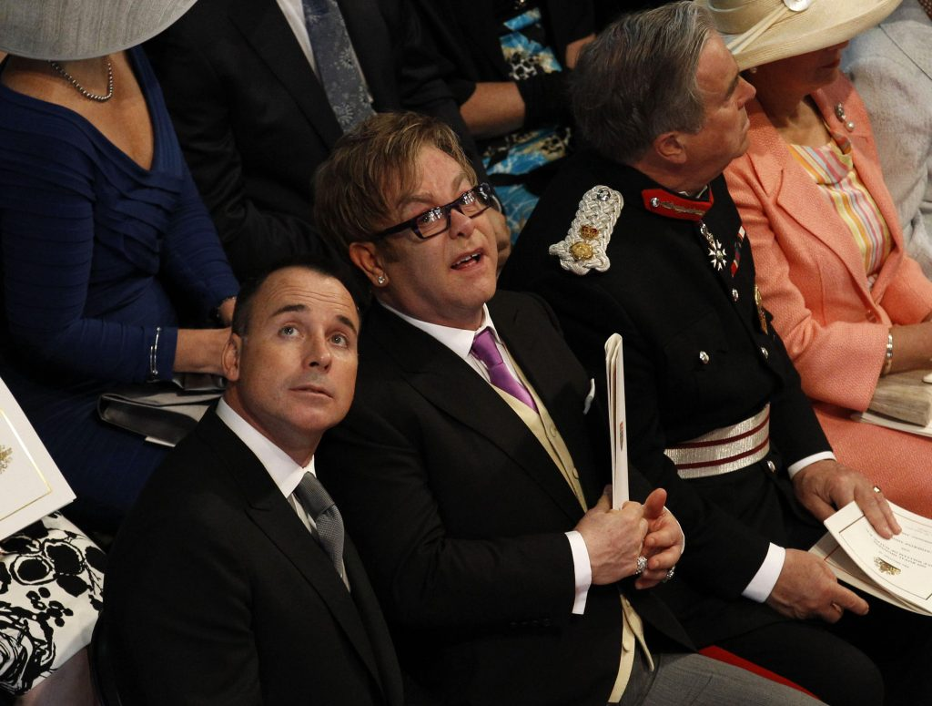 British singer Elton John (center) and his partner David Furnish (left) attend the wedding ceremony. Photo by Suzanne Plunkett/Reuters