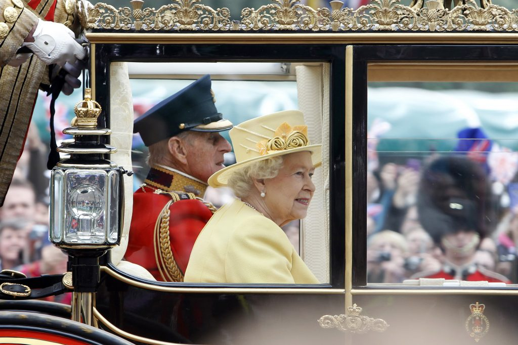 Britain's Queen Elizabeth II and Prince Philip travel to Buckingham palace after the wedding. Photo by Nir Elias/Reuters