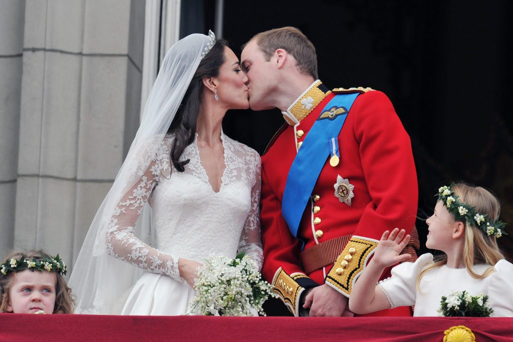 The post-wedding kiss from the balcony of Buckingham Palace. Photo by John Stillwell/Pool via Reuters