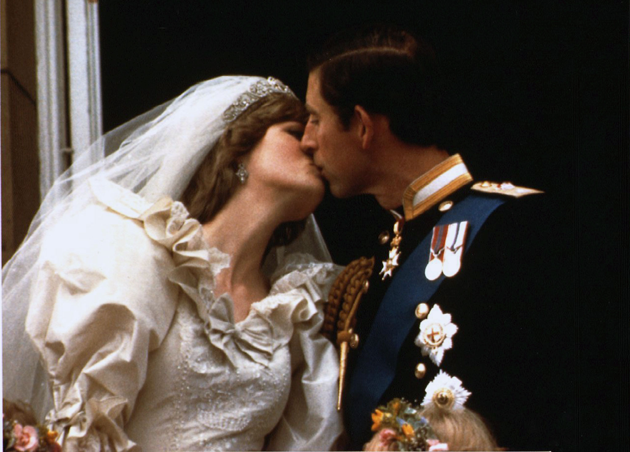 Prince Charles kisses his new bride Diana on their wedding day on July 29, 1981. Photo by Reuters