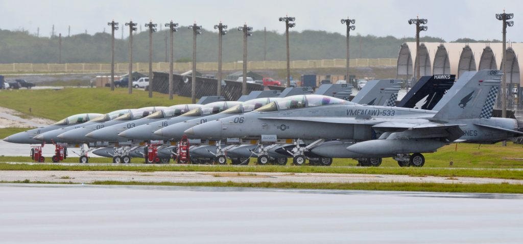 FILE PHOTO: Aircraft from Marine All Weather Fighter Attack Squadron 533 stand on the runway at Andersen Air Force Base, Guam September 15, 2014. U.S. Air Force/Staff Sgt. Robert Hicks/Handout/File Photo via REUTERS.