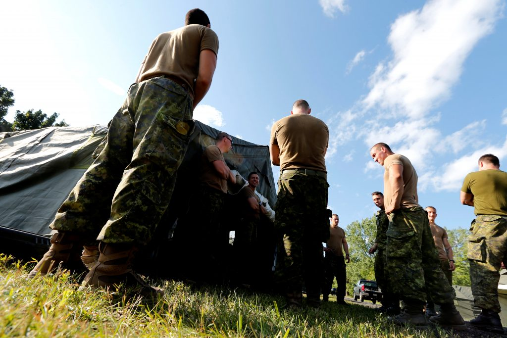 Members of the Canadian Armed Forces are erecting tents to house asylum seekers at the Canada-U.S. border in Lacolle, Quebec, on Aug. 9. Photo by Christinne Muschi/Reuters