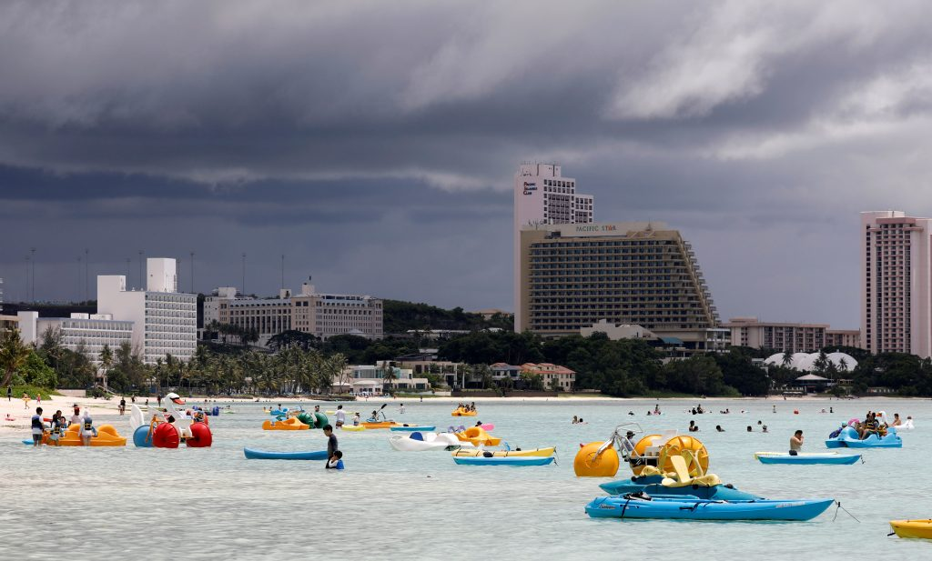 Tourists frolic on the waters overlooking posh hotels in Tumon tourist district on the island of Guam, a U.S. Pacific Territory, August 10, 2017. REUTERS/Erik De Castro