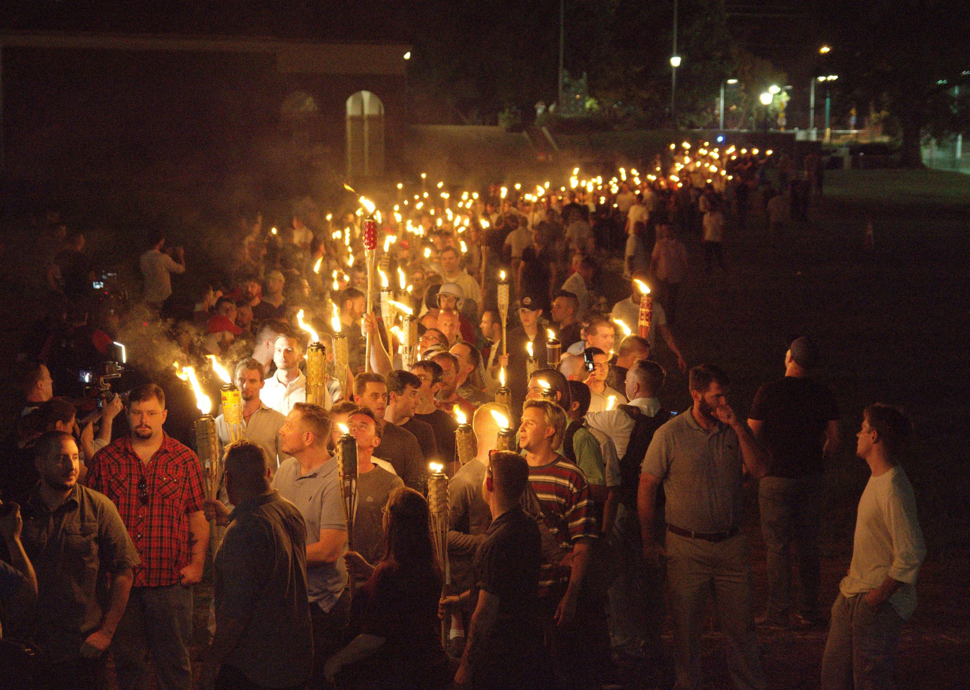 """White nationalists carry torches on the grounds of the University of Virginia, on the eve of a planned """"Unite the Right"""" rally in Charlottesville, Virginia, on Aug. 11, 2017. Photo by Alejandro Alvarez/News2Share via Reuters"""