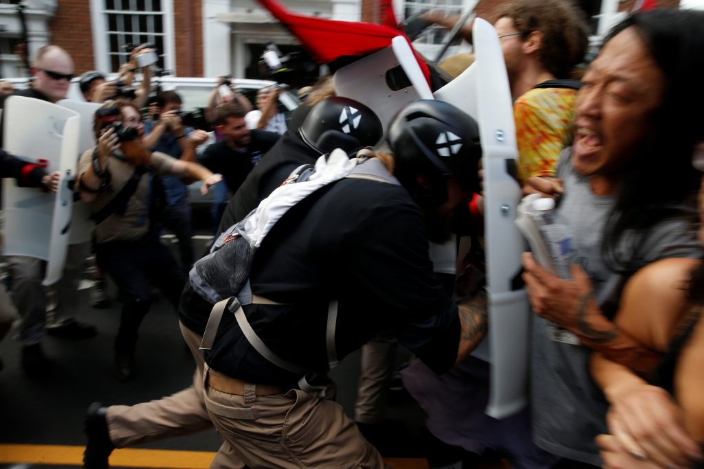Members of white nationalists clash a group of counter-protesters in Charlottesville Virginia