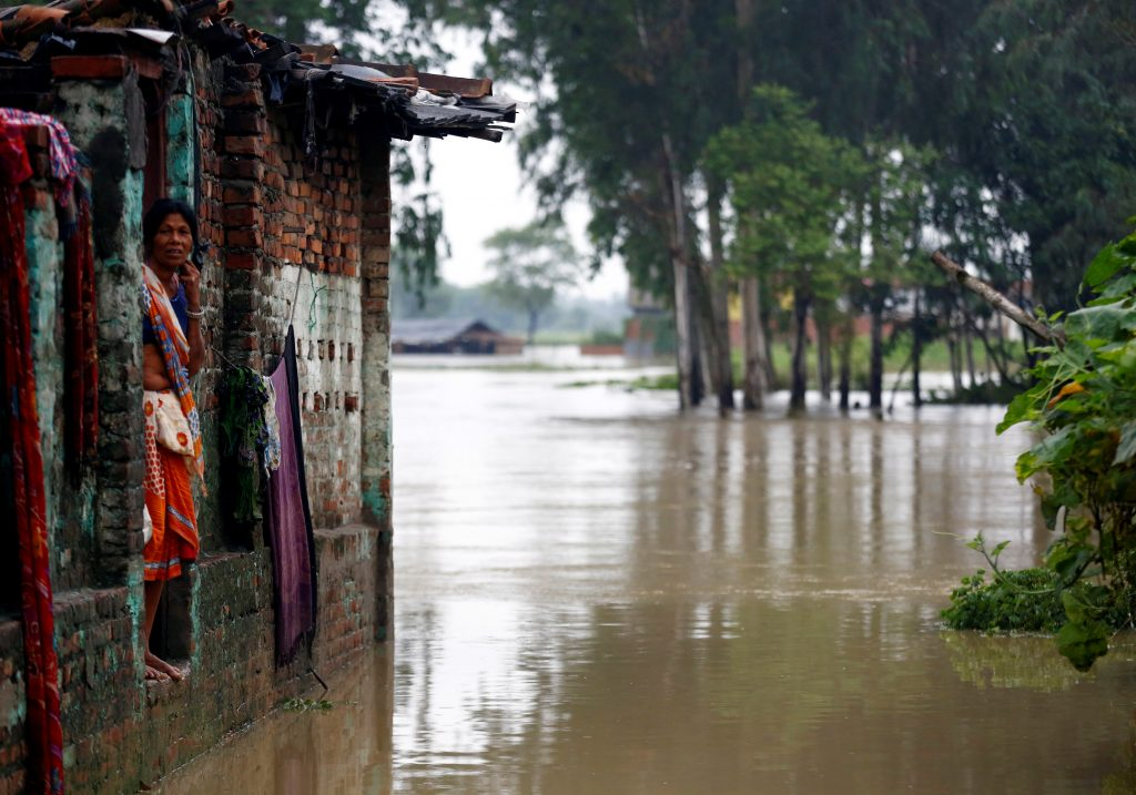 A woman looks out from her house at a flood-affected area in Janakpur, Nepal. Photo by Navesh Chitrakar/Reuters