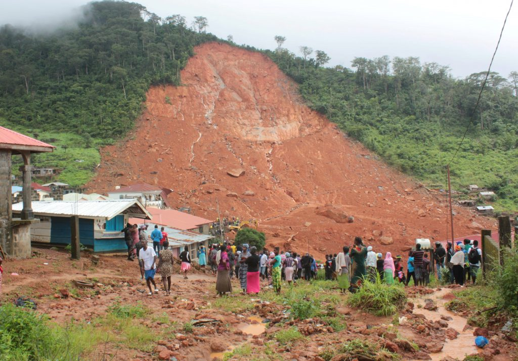 Residents survey the damages from a mudslide in the mountain town of Regent, Sierra Leone, on Aug. 14. Photo by Ernest Henry/Reuters