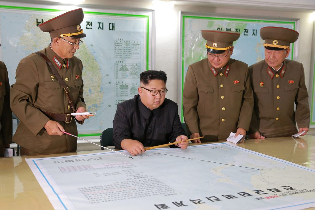 North Korean leader Kim Jong Un visits the Command of the Strategic Force of the Korean People's Army (KPA) in an unknown location in North Korea in this undated photo released by North Korea's Korean Central News Agency (KCNA) on August 15, 2017. KCNA/via REUTERS ATTENTION EDITORS - THIS PICTURE WAS PROVIDED BY A THIRD PARTY. NO THIRD PARTY SALES. SOUTH KOREA OUT. NO COMMERCIAL OR EDITORIAL SALES IN SOUTH KOREA. PICTURE BLURRED AT SOURCE. TPX IMAGES OF THE DAY - RTS1BTNV